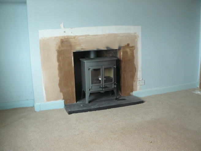 The second stove. Just a bit of painting and these rooms in the main house will be much improved.